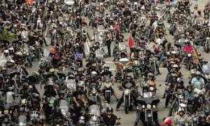 Harley Davidson motorcyclists ride through the streets of Barcelona