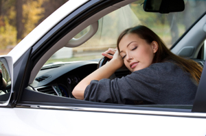 Young  woman sleeps in the car