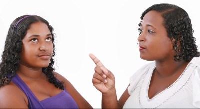 mother warn her daughter for bad behavior isolated on white