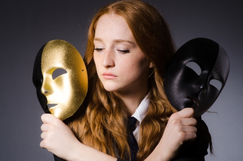 6870542 Woman with mask in hypocrisy concept