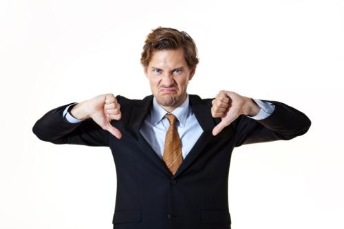 kozzi-4957338-unhappy_businessman_giving_thumbs_down-883x588.jpg