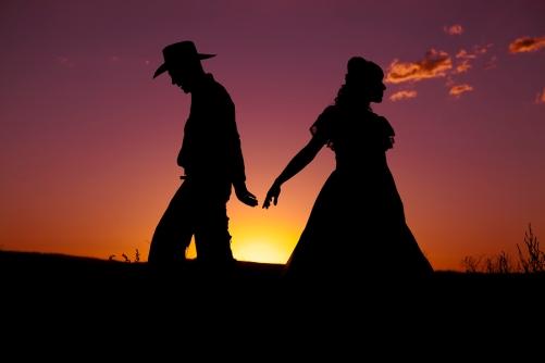 bigstock-Cowboy-Couple-Silhouette-Walk-23886545.jpg