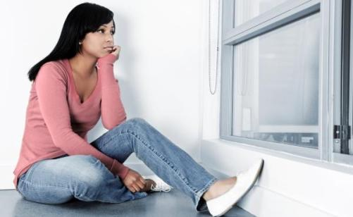 sad-woman-window-11091602.jpg