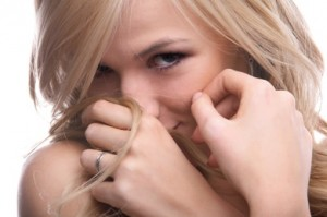 shy-woman-covering-her-face-with-her-hands-and-hair-300x199.jpg